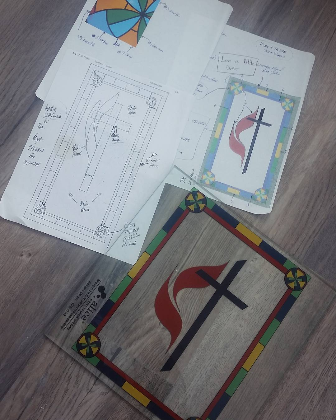 Final proof of the stained glass design with rough drafts