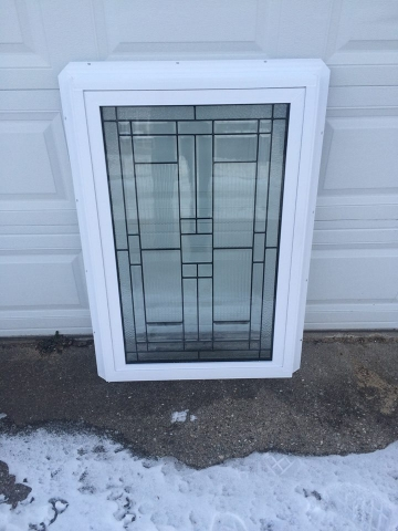 Custom glass design inside a new construction vinyl frame